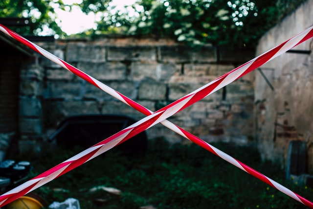 Picture of red and white tape sealing of an area (to represent access control)