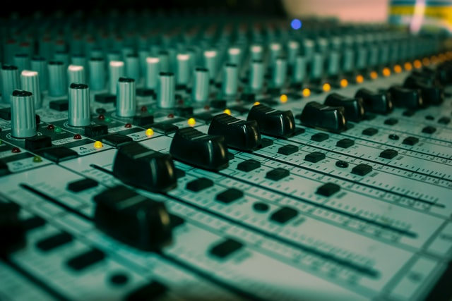 Picture of an audio mixing board (to represent configurations)
